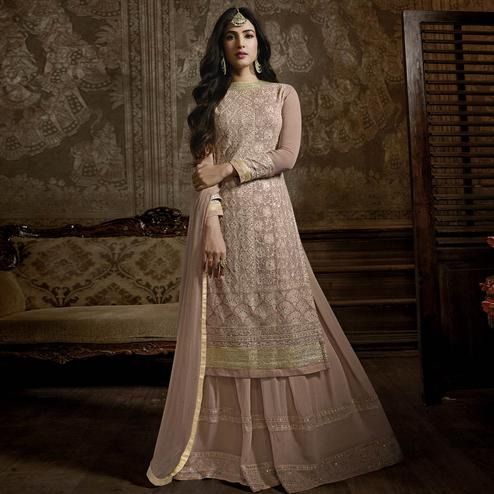 Sensational Rose Gold Colored Partywear Embroidered Faux Georgette Palazzo Suit