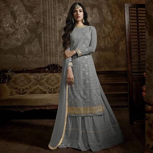 Stunning Grey Colored Partywear Embroidered Faux Georgette Palazzo Suit