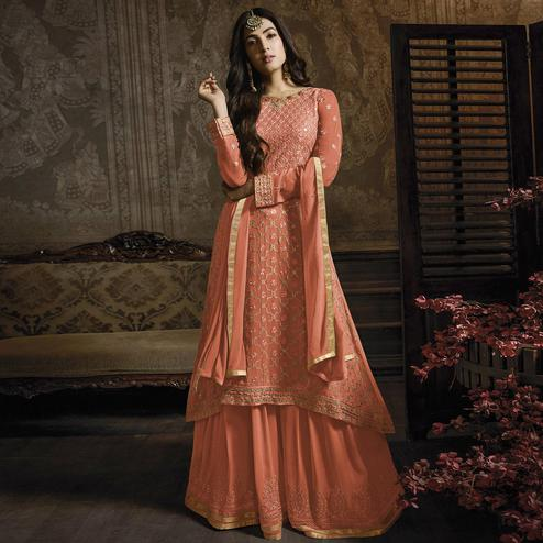 Breathtaking Peach Colored Partywear Embroidered Faux Georgette Lehenga Suit