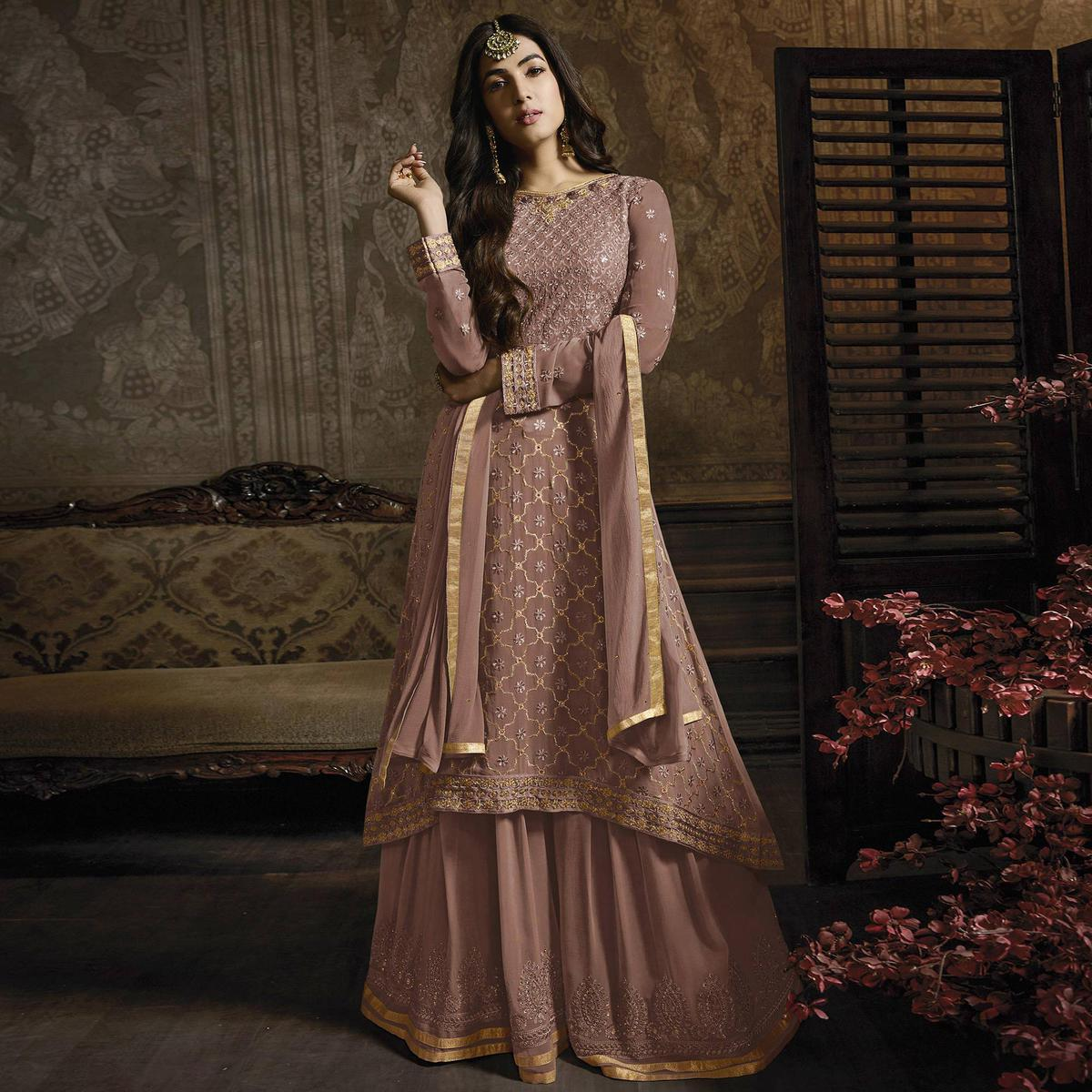 Ravishing Mauve Colored Partywear Embroidered Faux Georgette Lehenga Suit