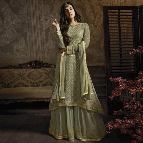 Staring Green Colored Partywear Embroidered Faux Georgette Lehenga Suit