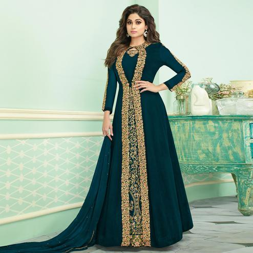 Flamboyant Teal Blue Colored Partywear Embroidered Faux Georgette Jacket Style Anarkali Suit