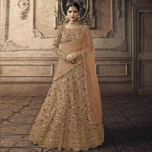 Adorable Beige Colored Partywear Embroidered Net Lehenga Choli