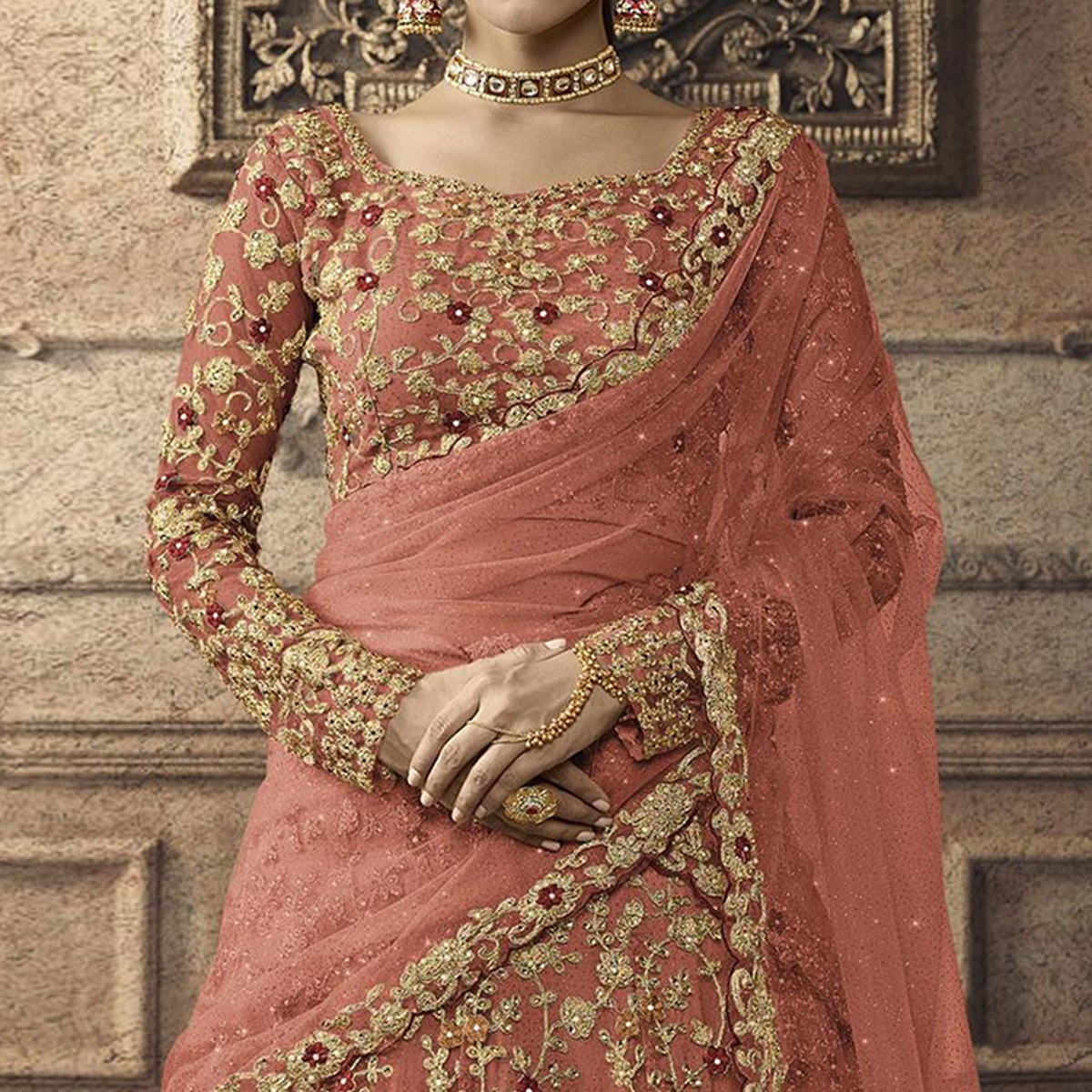 Glorious Peach Colored Partywear Embroidered Net Lehenga Choli
