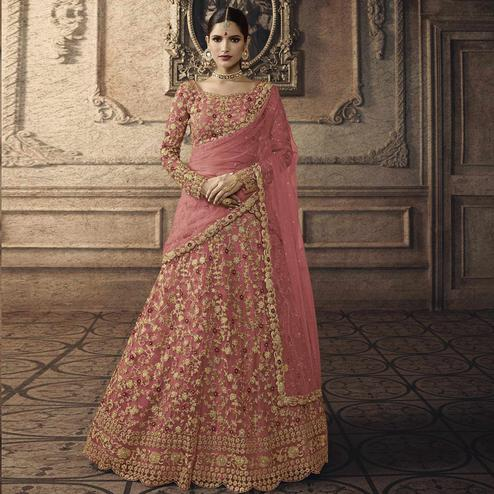 Attractive Pink Colored Partywear Embroidered Net Lehenga Choli