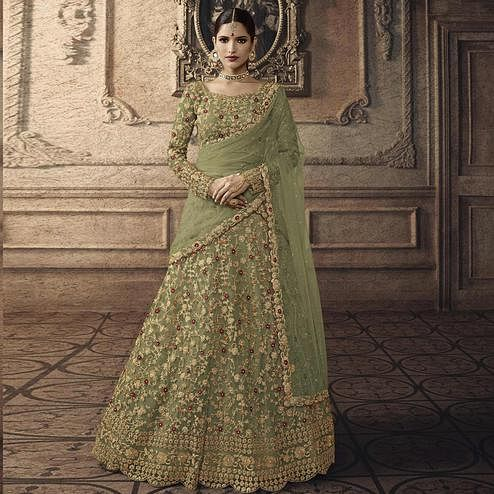 Beautiful Green Colored Partywear Embroidered Net Lehenga Choli
