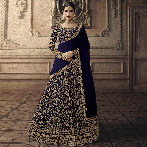 Jazzy Dark Blue Colored Partywear Embroidered Net Lehenga Choli