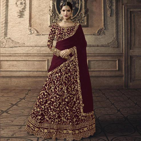 Engrossing Dark Wine Colored Partywear Embroidered Net Lehenga Choli