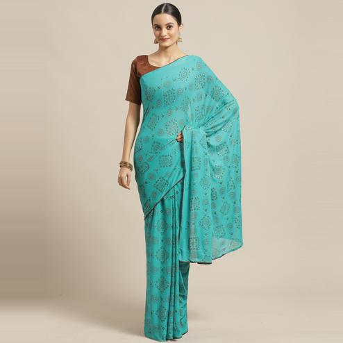 Gorgeous Teal Green Colored Casual Wear Printed Chiffon Saree