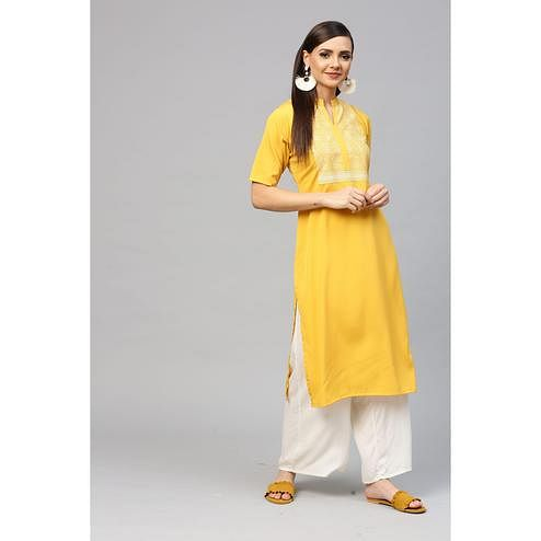 Ahalyaa - Yellow Colored Casual Pigment Crepe Kurti