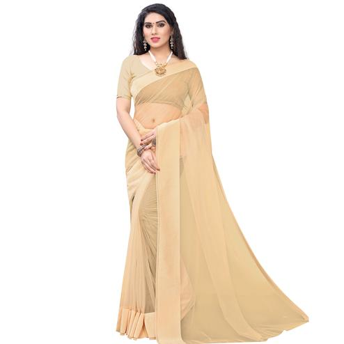 Prominent Cream Colored Party Wear Solid Organza Saree