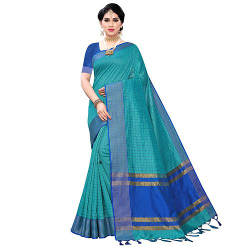 Ethnic Rama Green Colored Festive Wear Cotton Silk Saree With Tassels