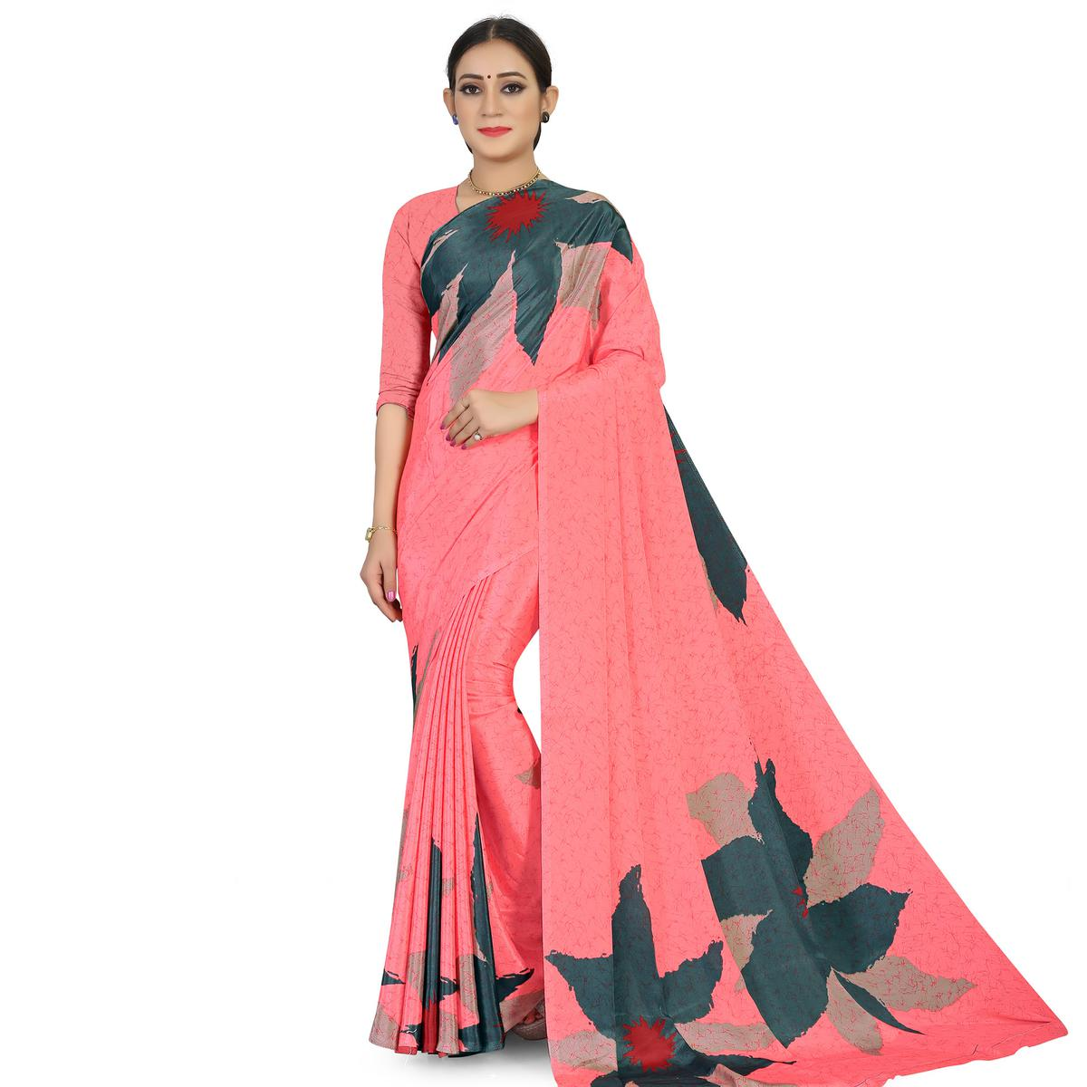 Captivating Peach Colored Casual Wear Printed Satin Saree