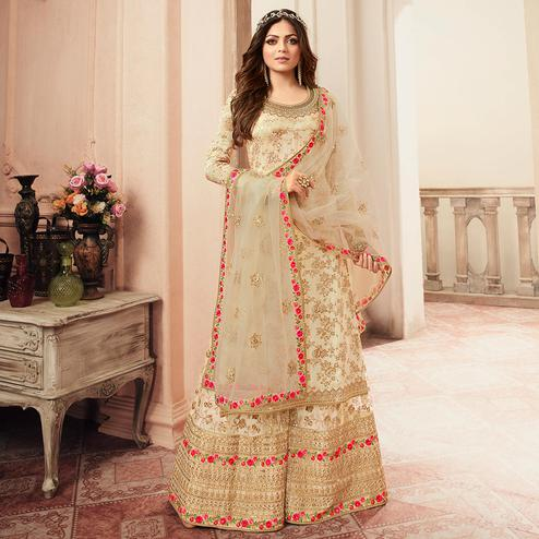 Ethnic Cream Colored designer Partywear Embroidered Dola Jacquard Palazzo Suit