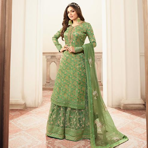 Dazzling Light Green Colored designer Partywear Embroidered Dola Jacquard Palazzo Suit