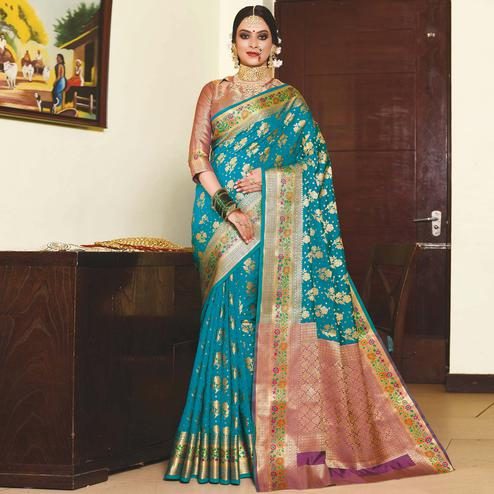 Innovative Turquoise Blue Colored Festive Wear Woven Silk Saree