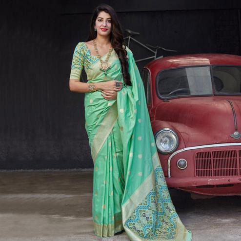 Dazzling Green Colored Festive Wear Woven Silk Saree