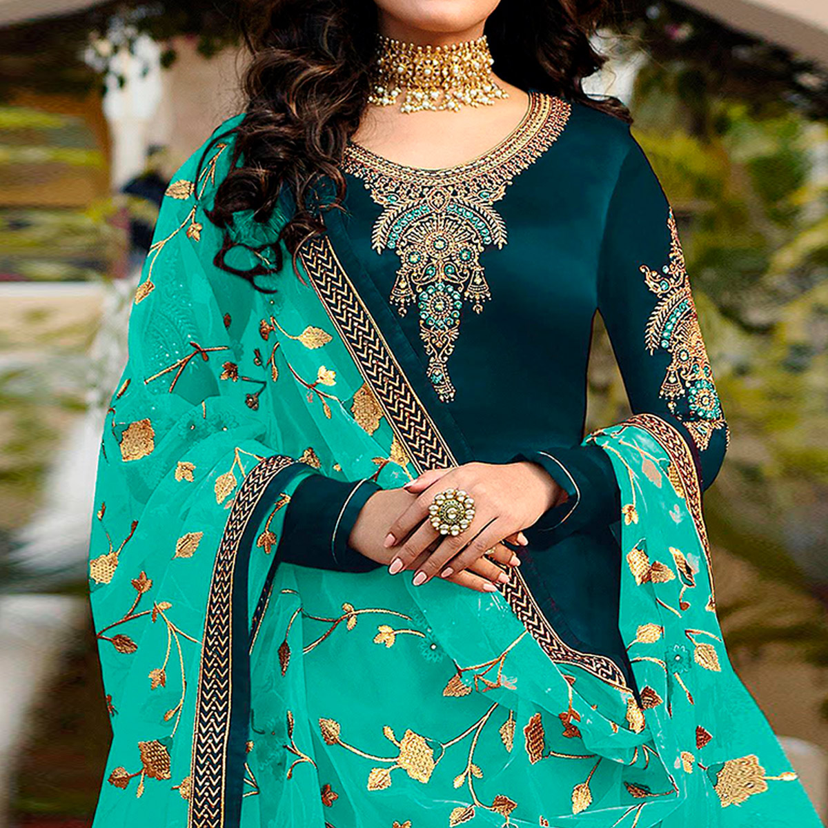 Prominent Teal Blue Colored Partywear Embroidered Satin Georgette Suit