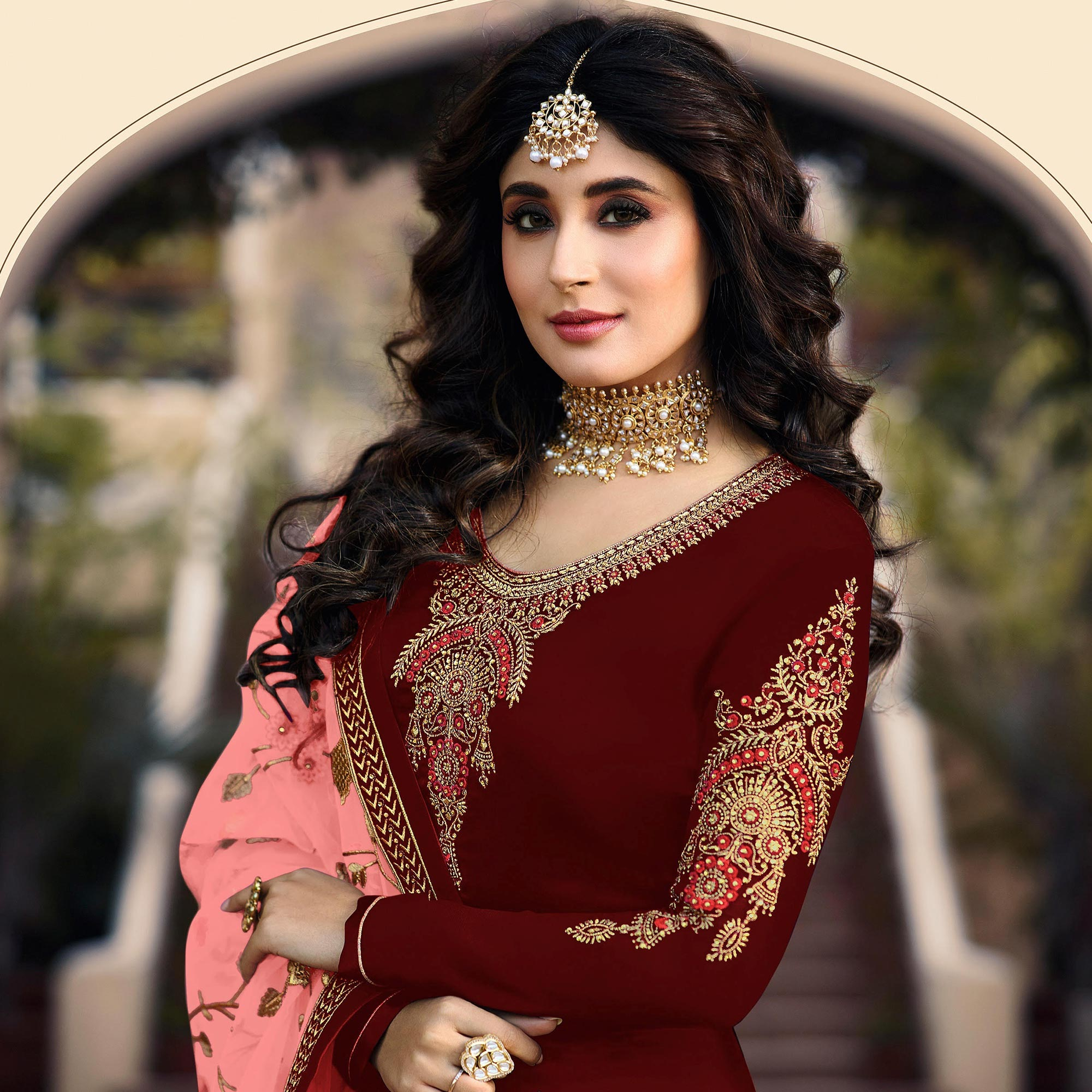 Capricious Maroon Colored Partywear Embroidered Satin Georgette Suit