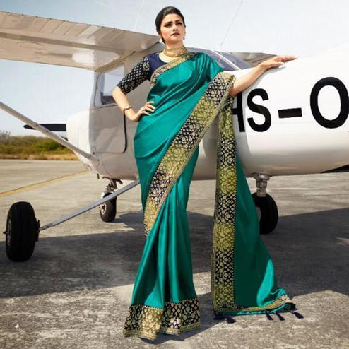 Exclusive Turquoise Green Colored Partywear Woven Silk Saree
