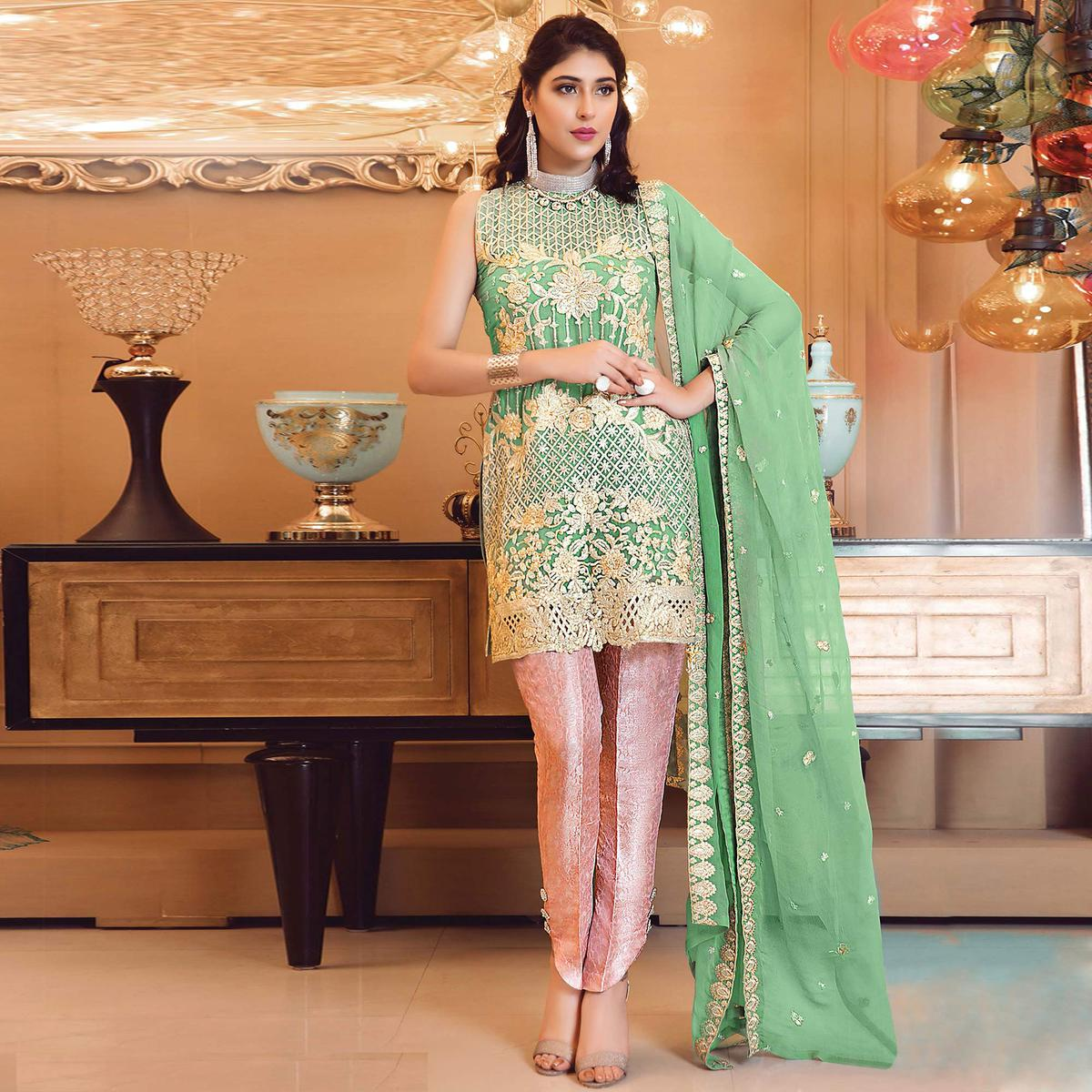 Amazing Green Colored Partywear Embroidered Faux Georgette Straight Suit