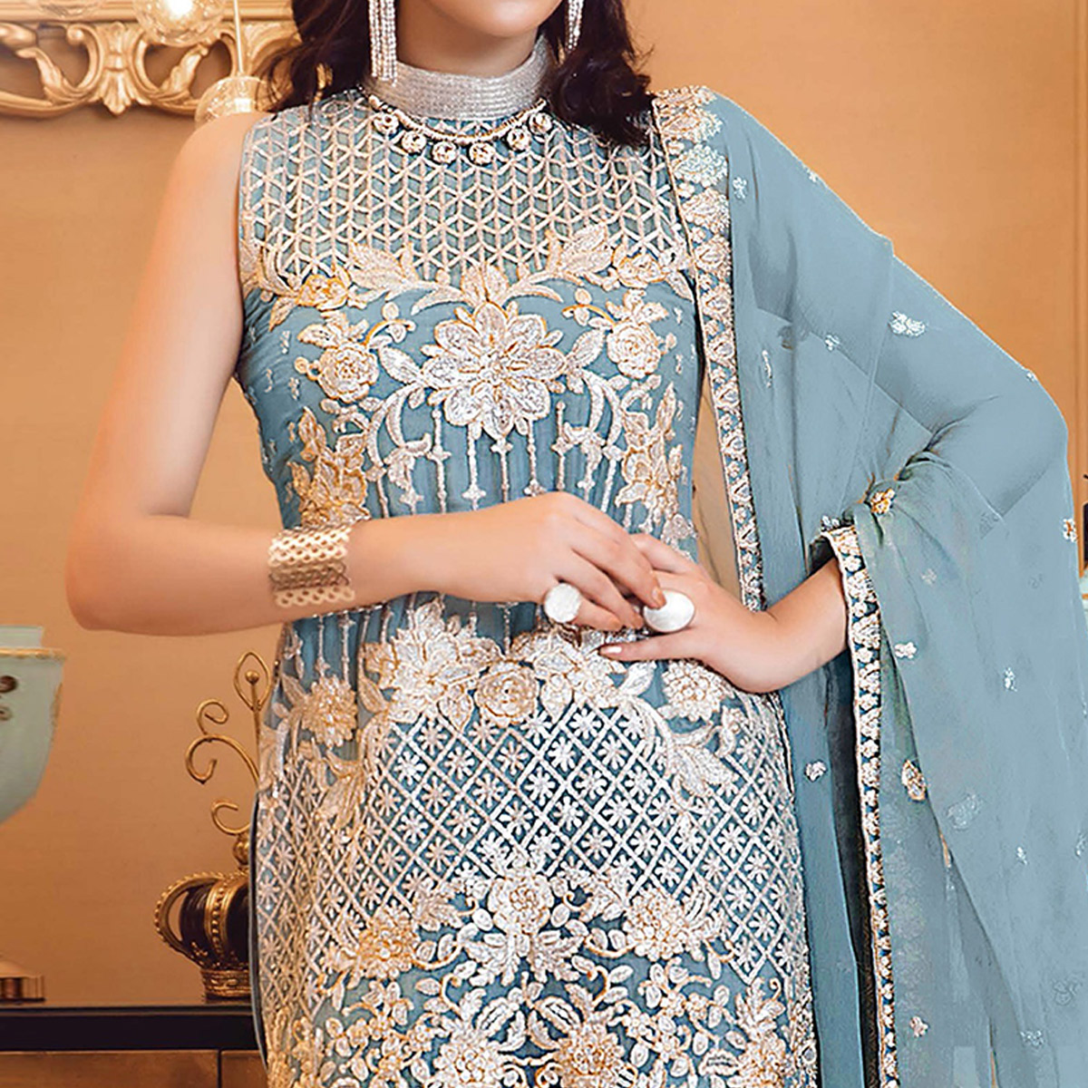 Blissful Sky Blue Colored Partywear Embroidered Faux Georgette Straight Suit
