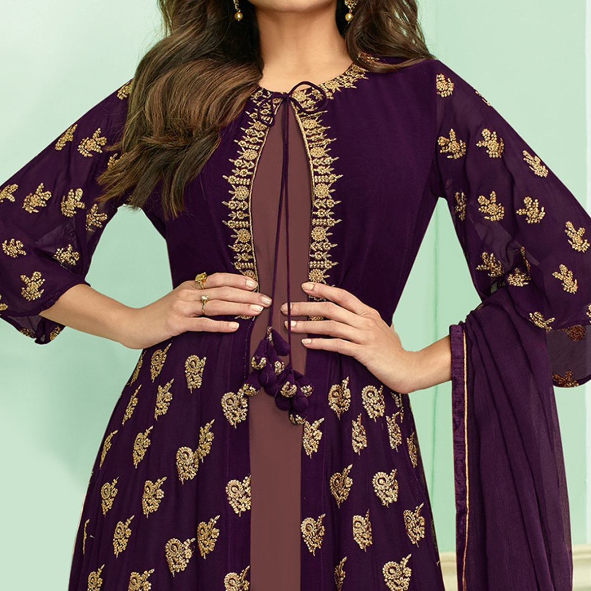 Dazzling Purple Colored Partywear Embroidered Faux Georgette Palazzo Suit
