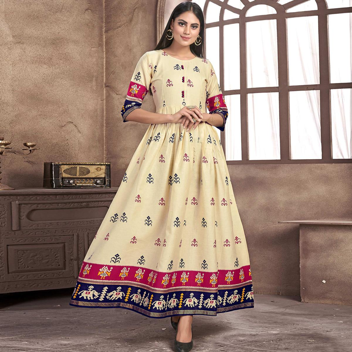 Alluring Cream Colored Partywear Printed Jam Satin Kurti