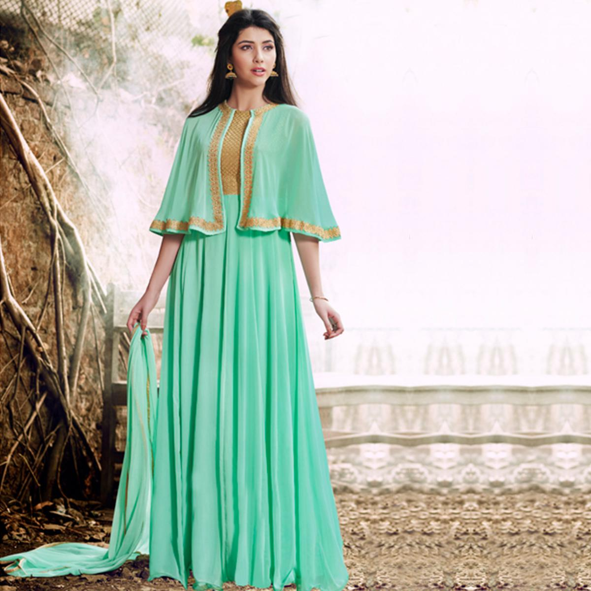 NAKKASHI - Demanding Turquoise Colored Party Wear Embroidered Georgette Suit