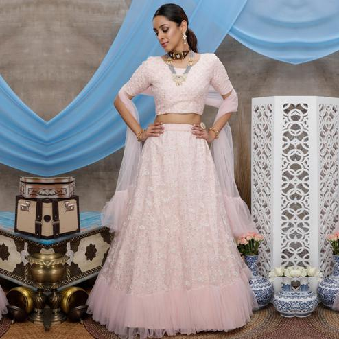 Desirable Pastel Peach Colored Party Wear Embroidered Net Lehenga Choli