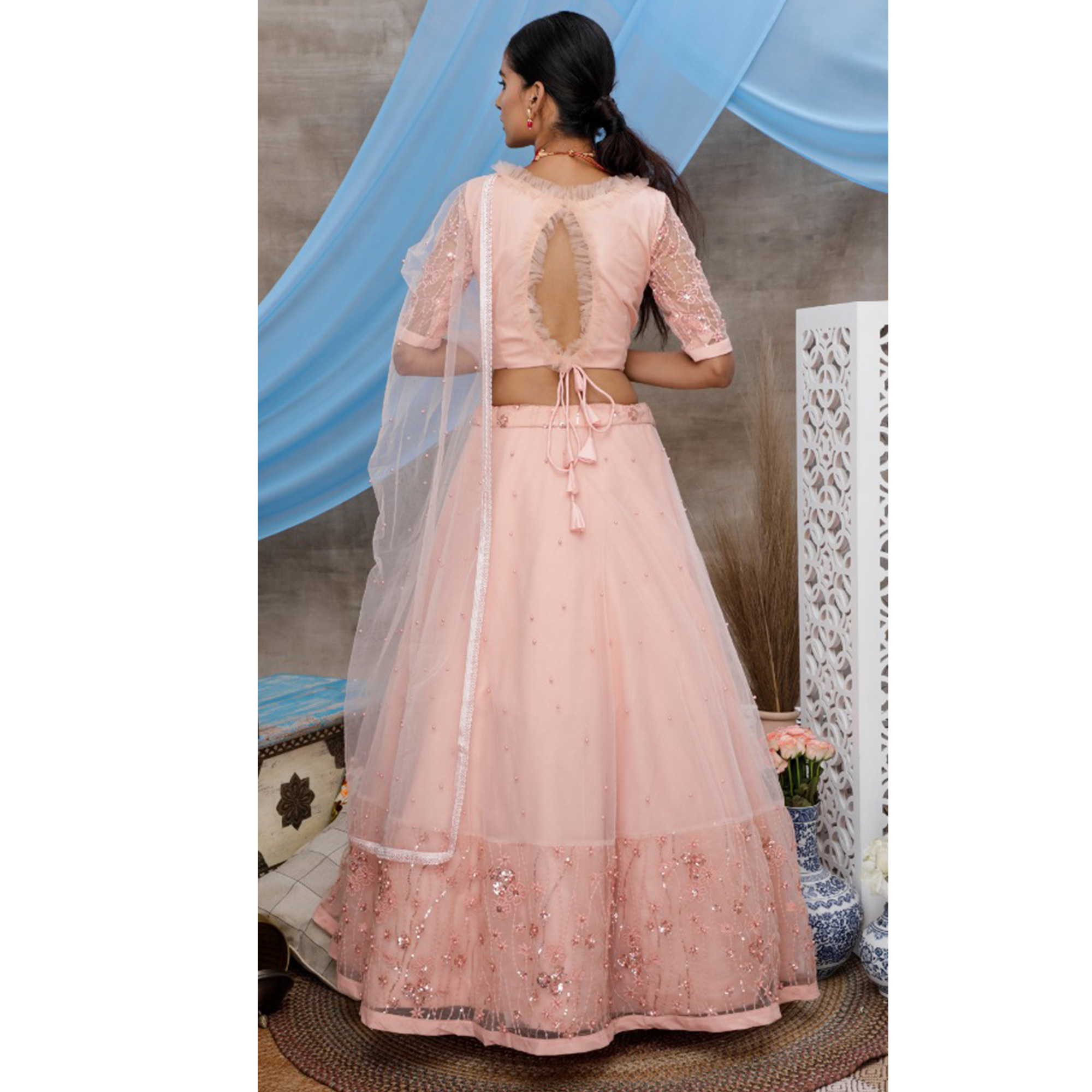 Elegant Peach Colored Party Wear Embroidered Net Lehenga Choli