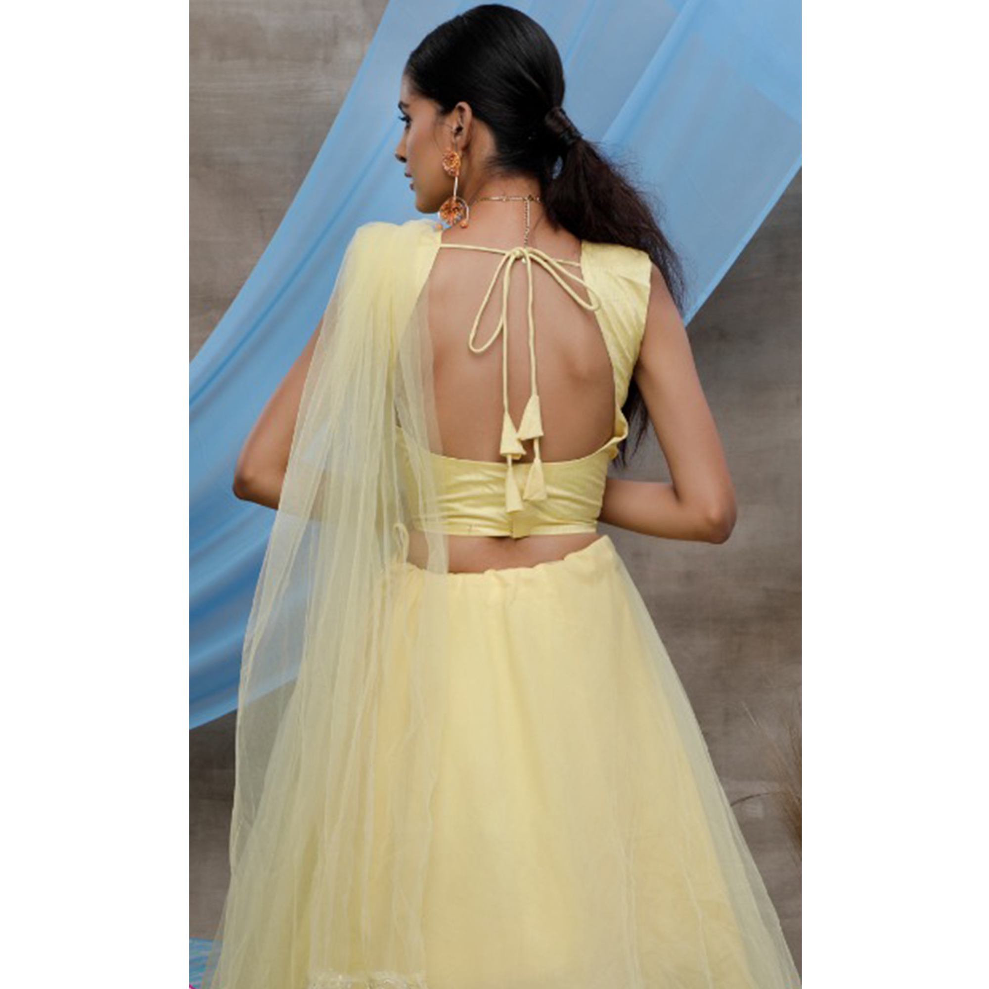 Radiant Yellow Colored Party Wear Embroidered Net Lehenga Choli