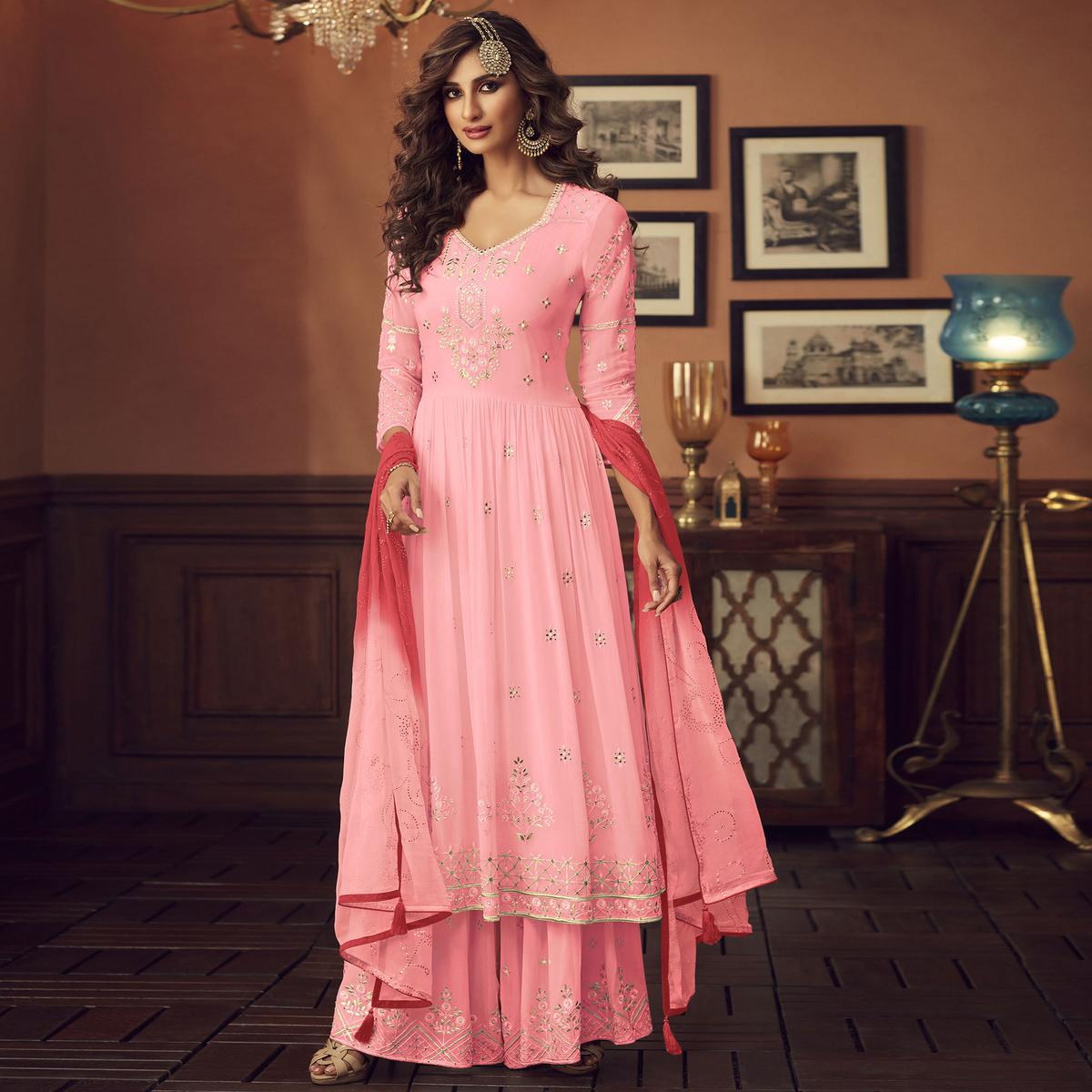 Desirable Pink Colored Party Wear Embroidered Faux Georgette Palazzo Suit