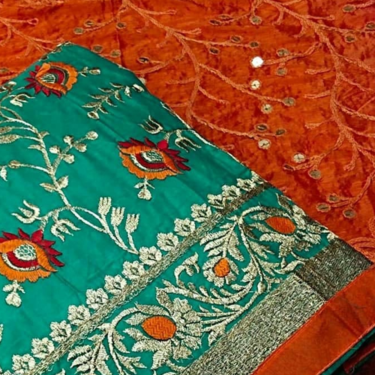 Ideal Turquoise Blue Colored Partwear Embroidered Chanderi Cotton Dress Material