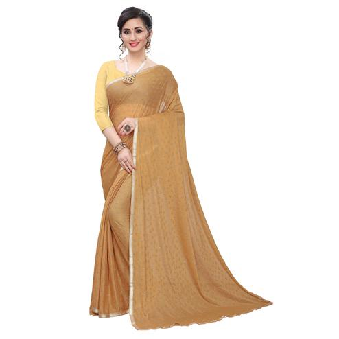 Mesmeric Beige Colored Casual Wear Printed Lycra Blend Saree