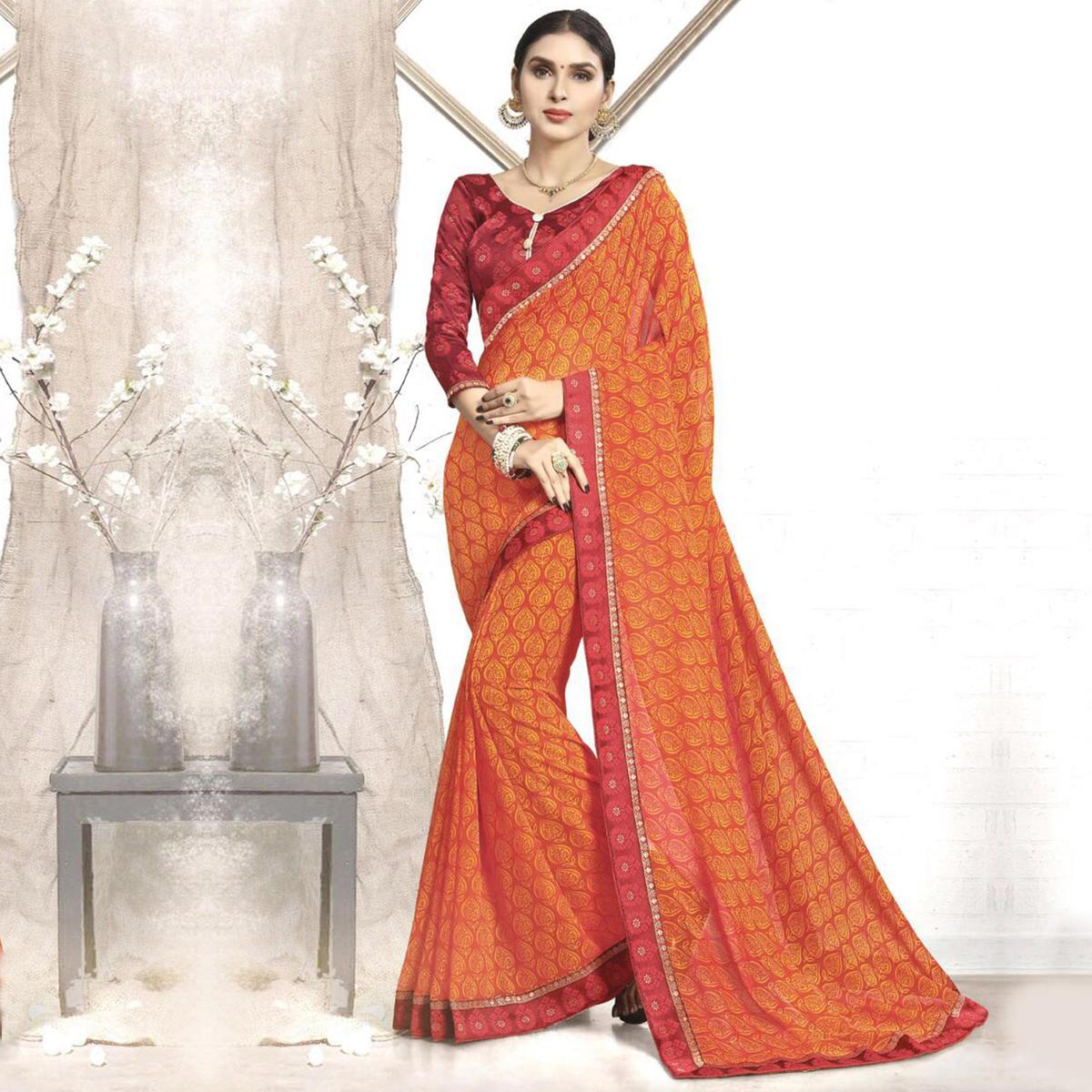 Flamboyant Orange Casual Wear Printed Faux Georgette Saree