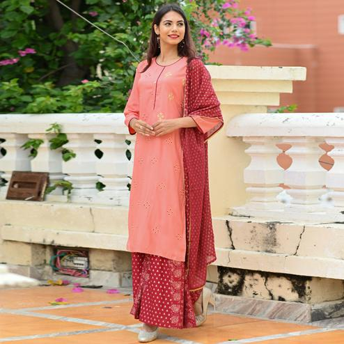 Alluring Peach Colored Partwear Foil Printed Rayon Kurti-Palazzo Set With Dupatta