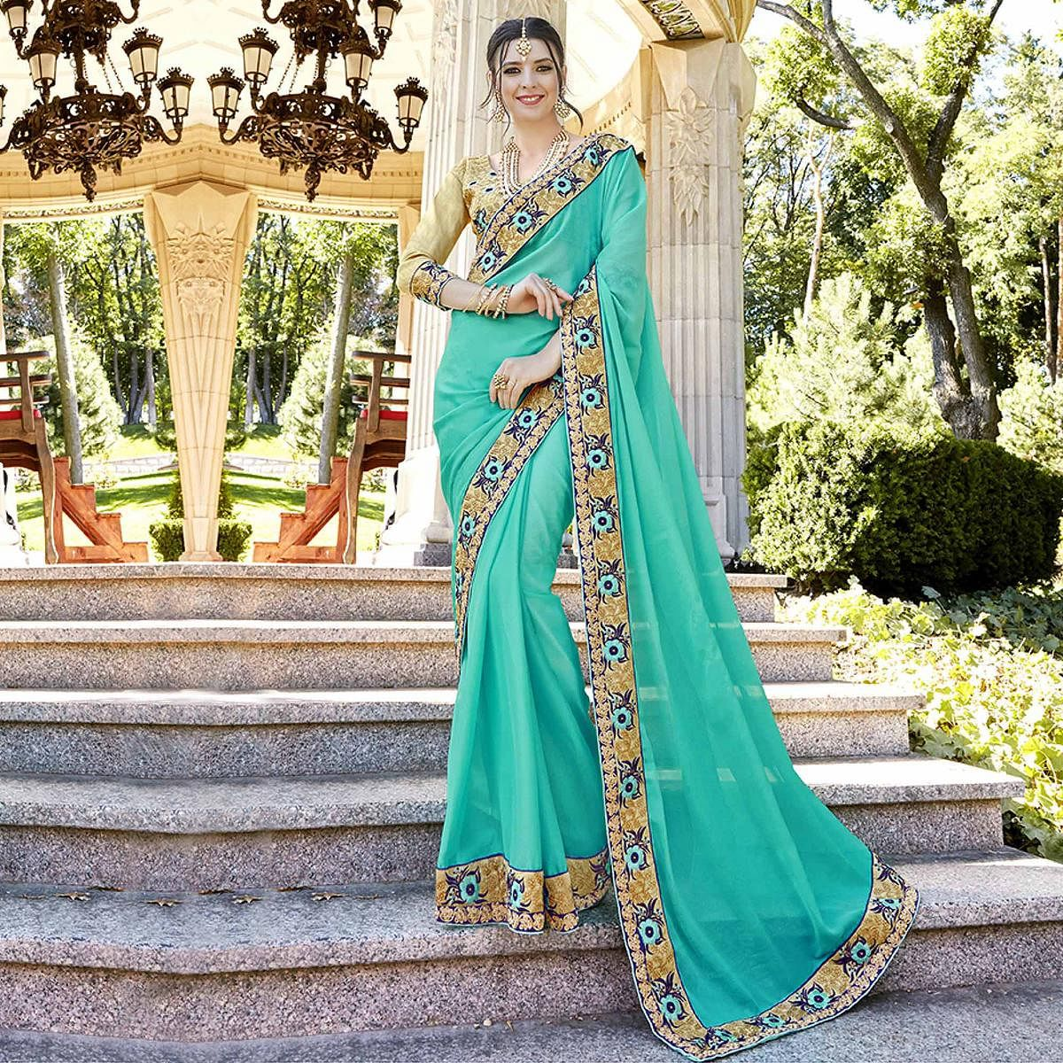 Charming Blue Designer Embroidered Georgette Saree