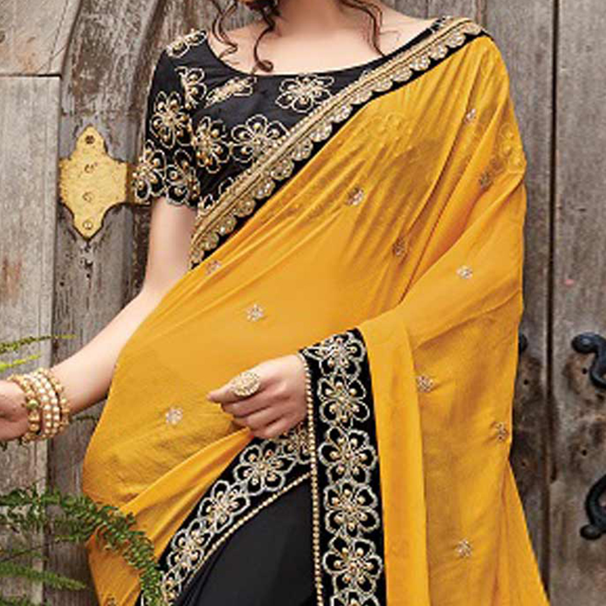 Sizzling Black-Yellow Designer Embroidered Partywear Georgette & Chiffon Saree