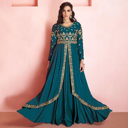 Desirable Teal Blue Colored Partywear Embroidered Tapeta Silk Gown