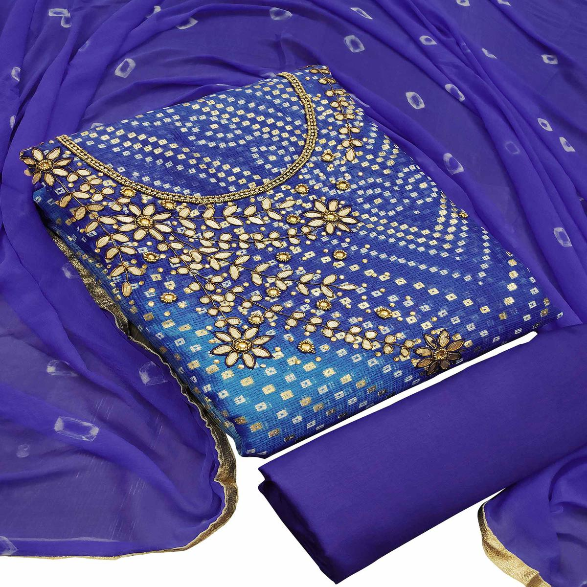 Radiant Violet Colored Partywear Embroidered Heavy Banarasi Silk Dress Material