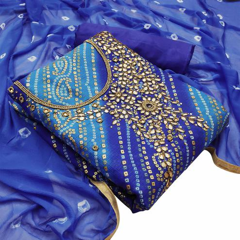 Glowing Blue Colored Partywear Embroidered Heavy Banarasi Silk Dress Material