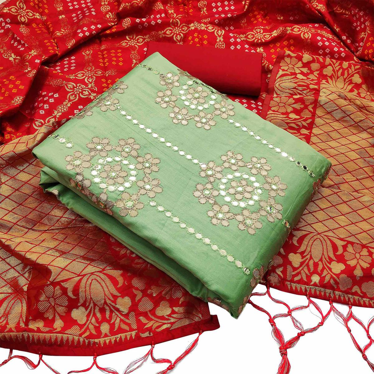 Adorable Green Colored Partywear Embroidered Heavy Glass Cotton Dress Material