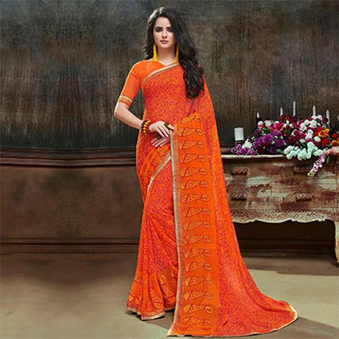 Ravishing Orange Partywear Embroidered Georgette Saree