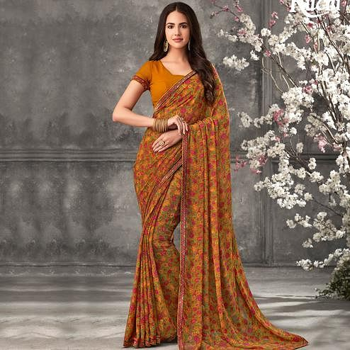 Trendy Orange Colored Casual Wear Printed Georgette Saree