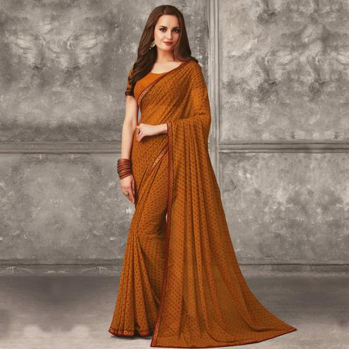 Glowing Rust Orange Colored Casual Wear Printed Georgette Saree