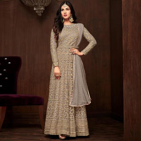 Imposing Gray Colored Partywear Embroidered Netted Anarkali Suit