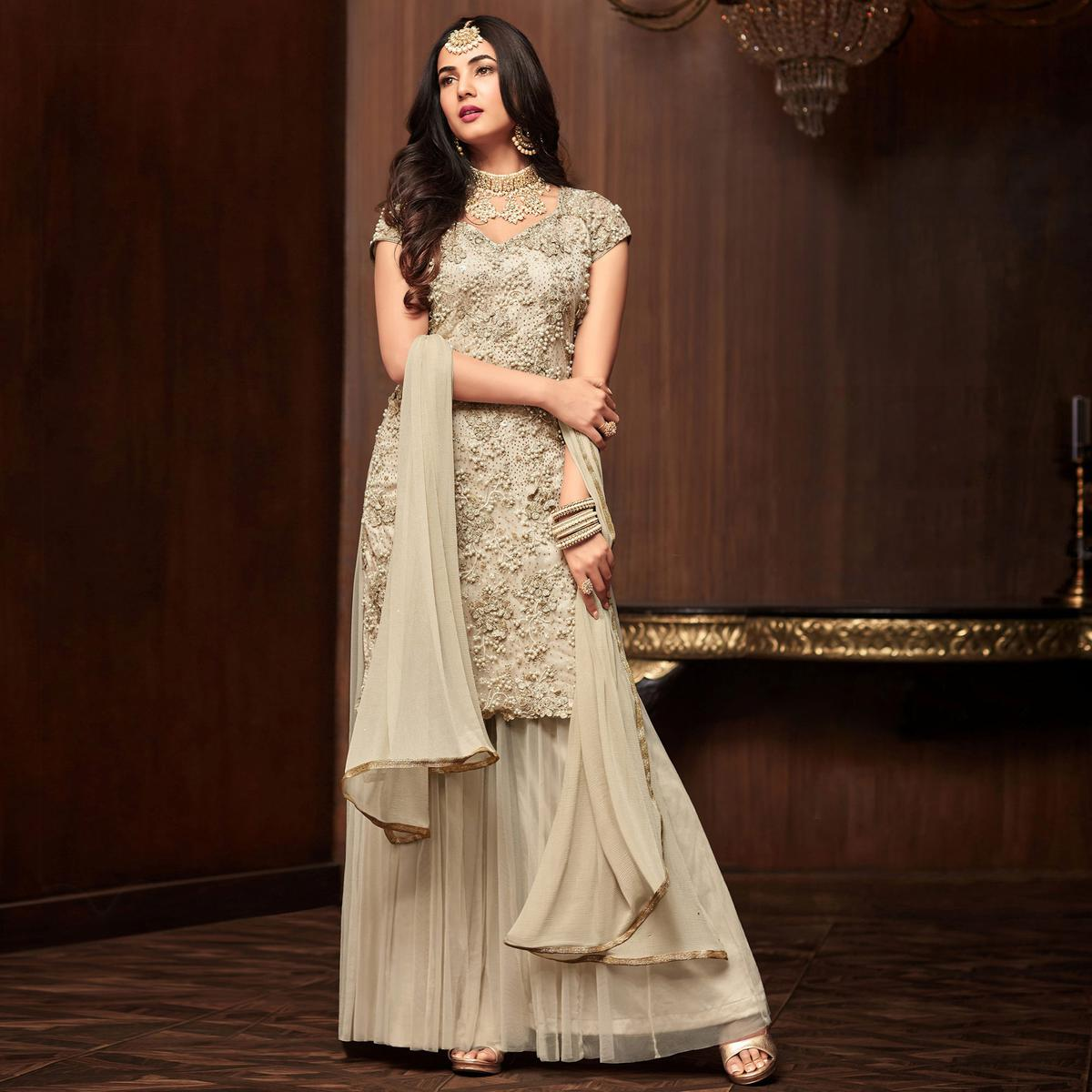 Majesty Off White Colored Partywear Embroidered Netted Palazzo Suit
