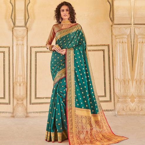 Engrossing Rama Green Colored Festive Wear Woven Handloom Silk Saree
