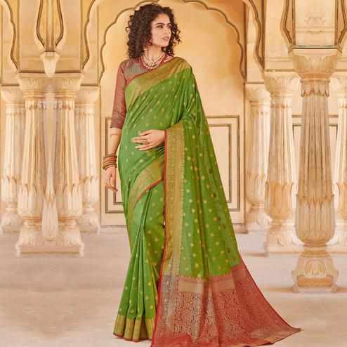 Eye-catching Green Colored Festive Wear Woven Handloom Silk Saree